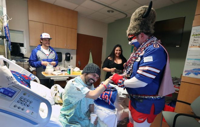 Ezra Castro and Captain Buffalo last week at MD Anderson Cancer Center in Houston, Texas. (James P. McCoy/Buffalo News)
