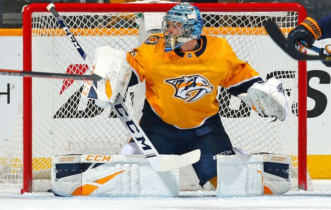 Pekka Rinne outdueled Carter Hutton as the Predators posted a 2-1 win over the Sabres Dec. 3 in Nashville. (Getty Images)
