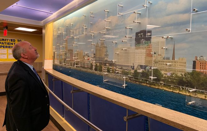 Thomas Jasinski Jr. examines a donor wall at the Regional Center of Excellence for Transplantation and Kidney Care at Erie County Medical Center. The name of his his living kidney donor, Paul Broderick, is among those listed. (Scott Scanlon/Buffalo News)