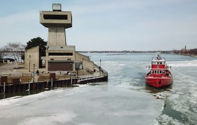 Edward Cotter breaks ice and passes the Observation Tower at Erie Basin Marina on Tuesday, April 2, 2019, in Buffalo N.Y. (John Hickey/Buffalo News)
