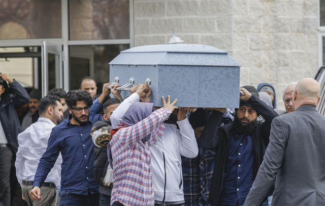 Mourners carry the casket of 12-year-old Badraldeen Mohamad Elwaseem out of Masjid Al Huda in Lackawanna on Monday afternoon. (Derek Gee/Buffalo News)