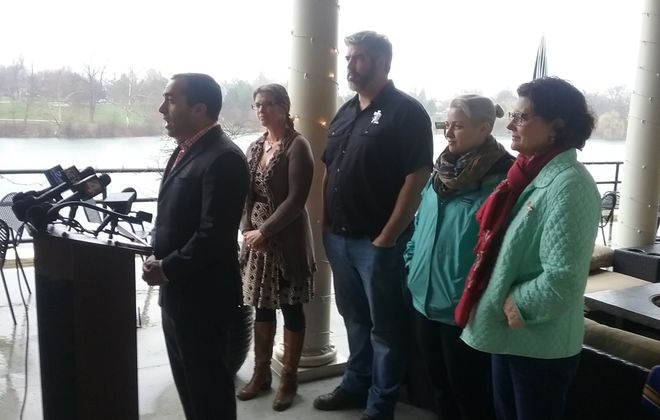 Delaware Council Member Joel Feroleto announces plans for an Earth Day clean-up in Buffalo. (Matt Glynn/Buffalo News)
