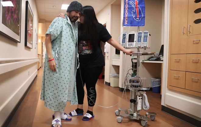 Ezra Castro – who has become famous as Pancho Billa – with his longtime partner, Veronica Borjon, earlier this month at the MD Anderson Cancer Center, in Houston. (James P. McCoy/Buffalo News)