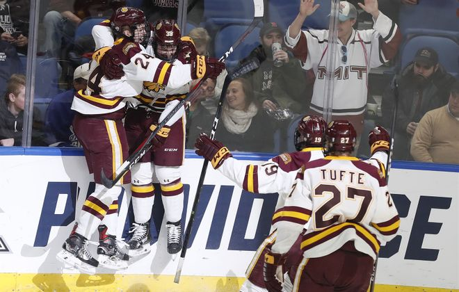 Minnesota Duluth won its second consecutive national championship in men's hockey Saturday at KeyBank Center, but the Bulldogs won in an NHL venue that had nearly 5,500 empty seats. Here Bulldogs defenseman Mikey Anderson (24) and forward Parker Mackay (39) celebrate Mackay's goal in the first period. (Mark Mulville/Buffalo News)