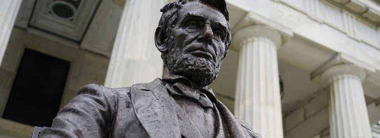 The Buffalo History Museum's best-known Abraham Lincoln piece is the bronze statue completed in 1902, mounted on black marble by sculptor Charles H. Niehaus that overlooks Hoyt Lake from the museum's portico. (Derek Gee/Buffalo News)