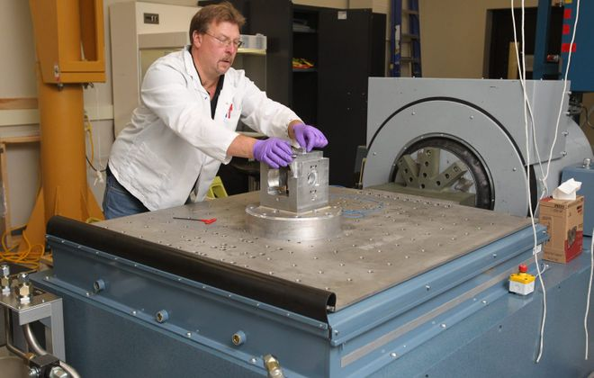 Engineering technician Dave Baranowski loads hardware on the vibration machine in the Vibrations Lab in Moog Inc.'s Elma complex. (Sharon Cantillon/News file photo}