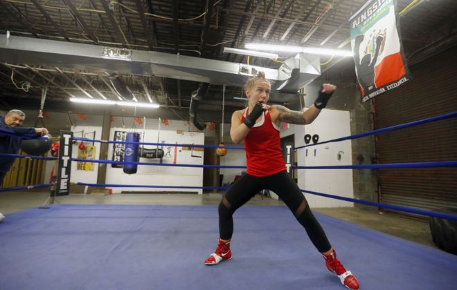 Boxer Mikiah Kreps shadow boxes in a mirror during her workout at the Gonzalez Boxing Club in Niagara Falls in April.     (Mark Mulville/News file photo)