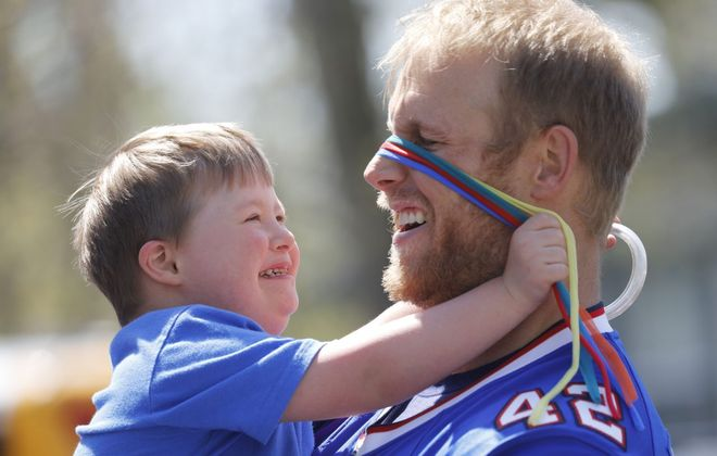 Daniel Anthony, 5, pretends to cover the eyes of Buffalo Bills fullback Patrick DiMarco as several Bills came to play with the children at Bornhava in conjunction with the NFL's Inspire Change Initiative on Monday, May 6, 2019. (Derek Gee/Buffalo News)