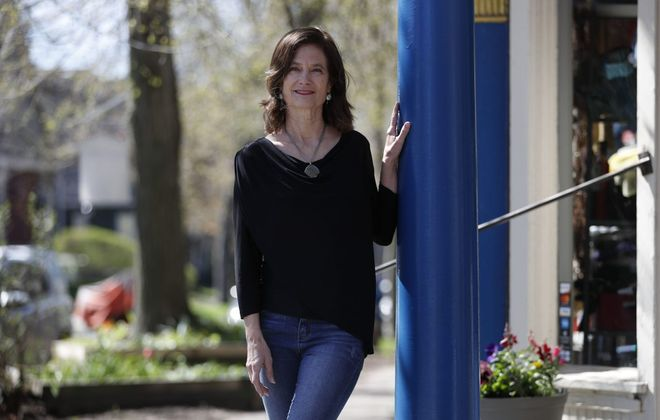 Stephanie Robb, jewelry designer and business owner, wears a favorite outfit outside her boutique, Turnstyle Designs, on Ashland Avenue.  (Sharon Cantillon/Buffalo News)