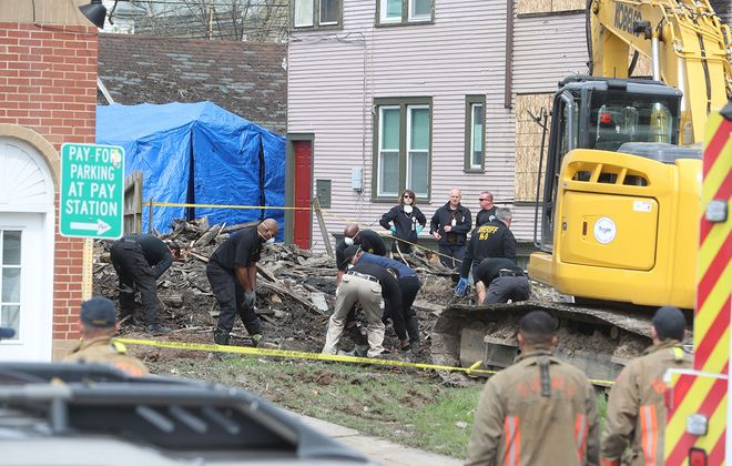 Investigators work at the site of a fire at 1074 Elmwood Ave., on Thursday, May 9, 2019.   (John Hickey/Buffalo News)