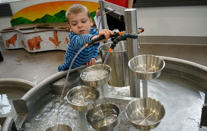 Jackson Davidson, 5, of Kenmore plays in the Moving Water exhibit at the new Explore & More – The Ralph C. Wilson Jr. Children's Museum at Canalside on Thursday, May 2, 2019. (Derek Gee/Buffalo News)