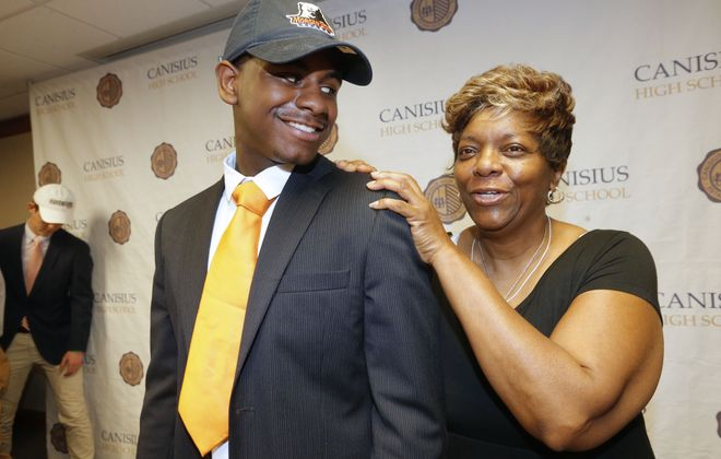 Canisius High School senior Jaurney Boyland and his grandmother Juanita Boyland are all smiles at the signing ceremony that formalizes his enrollment in Morgan State University, where he'll play football and major in business. (Robert Kirkham/Buffalo News)