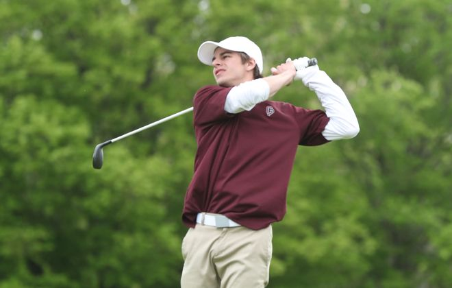Aidan Shaw of Orchard Park tees off on the 18th green. He won the Section VI golf championship at River Oaks Golf Course on Grand Island on Monday, May 20.  (James P. McCoy/Buffalo News)
