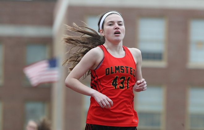 Brianna Grine of Olmsted wins the girls 1,500 meters during Wednesday's All-High meet. (James P. McCoy/Buffalo News)
