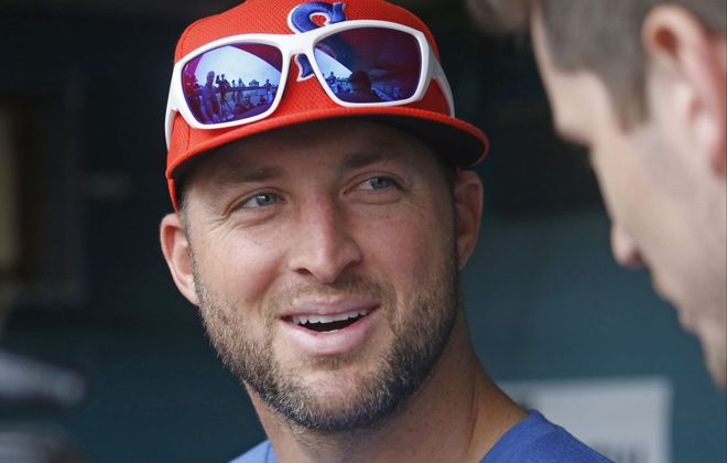 Tim Tebow speaks with local media before warmups with the Syracuse Mets at Sahlen Field Tuesday in Buffalo. (Robert Kirkham/Buffalo News)