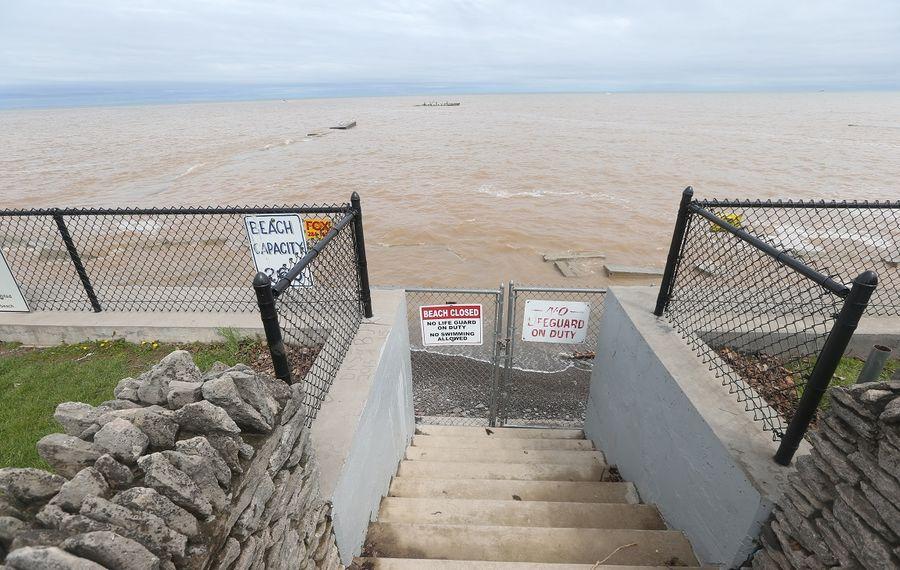 Waves wash over Krull Park Beach as Newfane Supervisor Timothy R. Horanburg said  Tuesday he is calling off the beach season as he did in 2017, the last time Lake Ontario flooded. (John Hickey/Buffalo News)