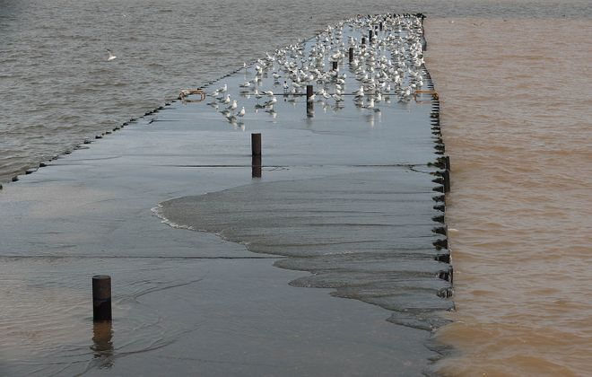 Water washes over Olcott's East Pier on May 20, 2019. (John Hickey/Buffalo News)
