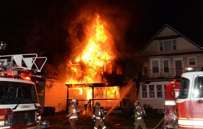A fire at 1276 Seneca St. on Oct. 2, 2015, heavily damaged a rental property whose sale was brokered by Kuwaiti real estate broker AbdulAziz HouHou. HouHou is imprisoned in Kuwait for running an international house flipping Ponzi scheme that involved about 160 properties in Buffalo, including this one.  (Photo courtesy of John Fecio)