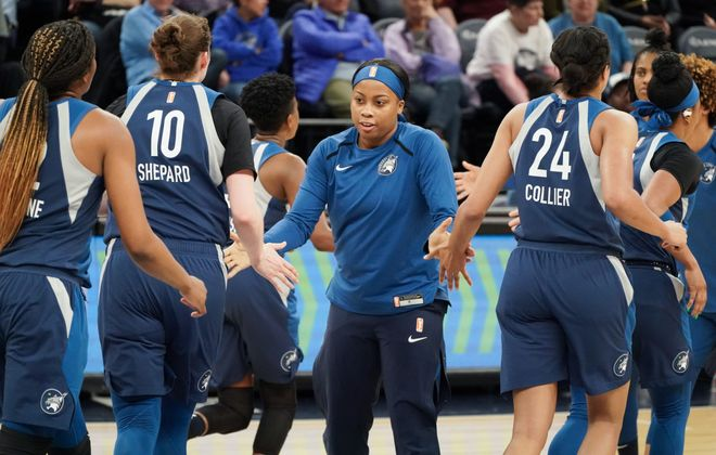Cierra Dillard cheered for the Minnesota Lynx from the bench during a preseason game Friday night. (Glen Stubbe/Special to the News)