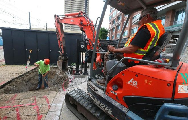 Contractors conduct an exploration dig on Main Street south of Exchange Street in 2018. (John Hickey/News file photo)