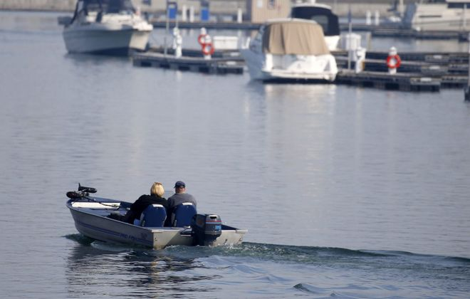 Cleaning off boats and other watercraft before re-launching into another water body is critical, the state Department of Environmental Conservation said. (Mark Mulville/Buffalo News file photo)