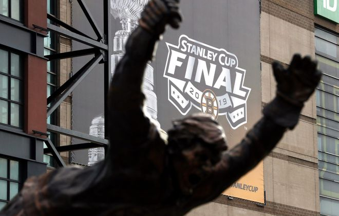 The 2019 NHL Stanley Cup final logo is seen through the Bobby Orr statue prior to Game One between the St. Louis Blues and the Boston Bruins at TD Garden in Boston. (Getty Images)