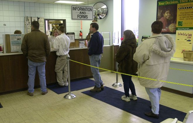 People wait in line at the Department of Motor Vehicles in Lockport, before DMVs shut down due to Covid-19. (Harry Scull Jr./News file photo)