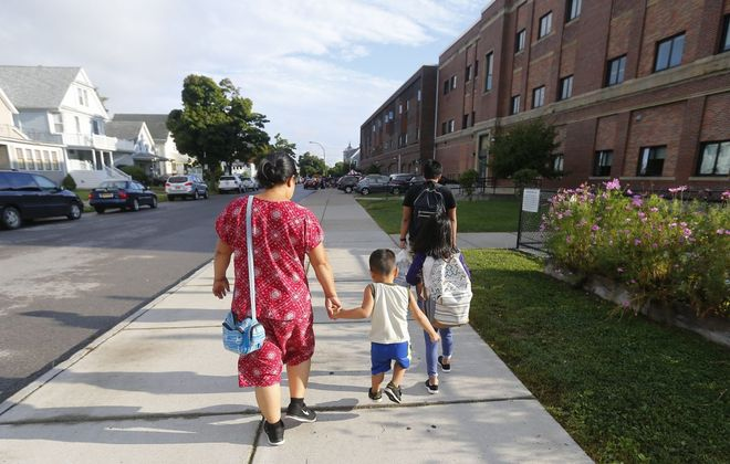 Students and parents walk to School 45 for the first day of classes in Buffalo Sept. 6, 2018. The district is looking at Sept. 11 for the first day of classes this September.  (Mark Mulville/News file photo)