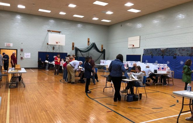Kenmore-Town of Tonawanda School District voters in the Hoover Middle School gym on Tuesday May 21, 2019. (Stephen T. Watson/Buffalo News)