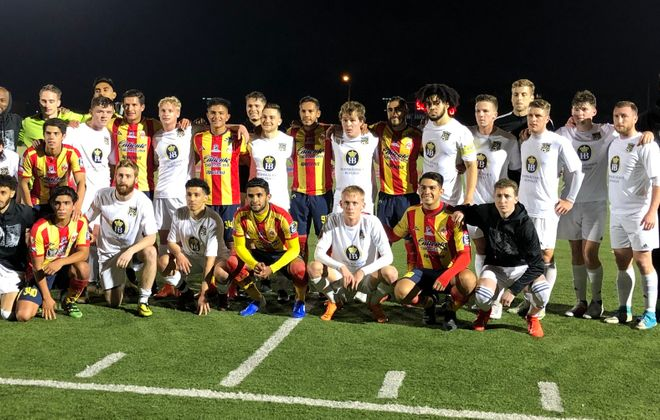 FC Buffalo and Monarcas Morelia players pose for a picture after Friday's match. (Ben Tsujimoto/Buffalo News)