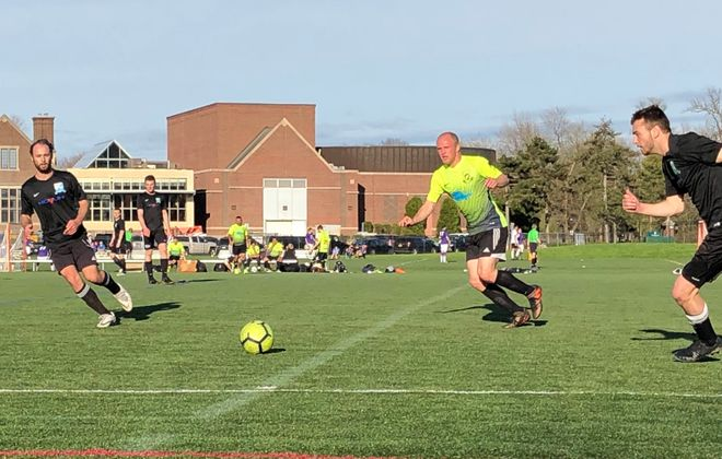 Williamsville Willies, in black, made a statement in Week 1 of the BDSL season. Can they topple Sharpshooters in Week 2? (Ben Tsujimoto/Buffalo News)