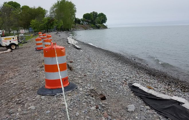 A 35-foot gap in the concrete barrier along the Lake Ontario shore in western Olcott, created by high waves on May 28, 2019. (Thomas J. Prohaska/Buffalo News)