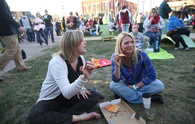 Robin Miller, left, and Janet Semsel, of Lockport, enjoy Larkin Square, at 745 Seneca St.  (Sharon Cantillon/Buffalo News)