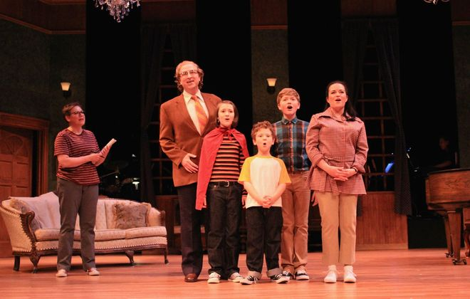 """Emotions spill into song in MusicalFare Theatre's production of """"Fun Home."""" Pictured as the  Bechdel family are, from left, Robyn Lee Horn (Alison), Chris J. Handley (Bruce/Dad), Jane Hereth (Small Alison), Jasper Brown (John), Joseph Bielecki (Christian), and Michele Marie Roberts (Helen). (Photo by Jesse Sloier)"""