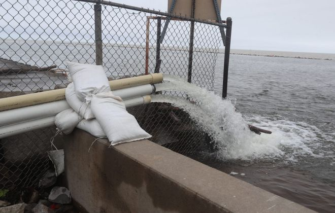 Flood water is pumped  back into Lake Ontario in Olcott in May 2019. (John Hickey/News file photo)