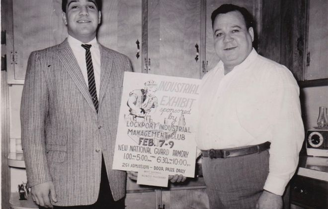 Nunzio T. Maiorana, left, and his father Salvatore Maiorana celebrate his winning a Lockport art show in 1957. (Contributed photo)