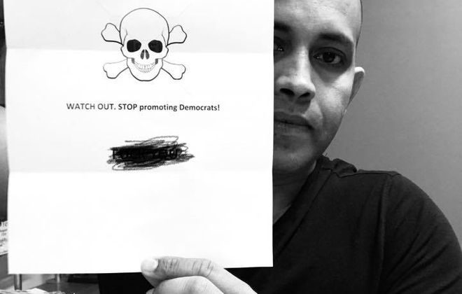 Sibu Nair, an Eggertsville resident and native of India who is active in Amherst Democratic politics, holds the letter he said he received in his mailbox last month. (Photo courtesy Sibu Nair)
