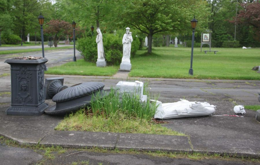 Overturned urns and a shattered statue of Jesus were among the damages done by vandals May 28-29, 2019, at Our Lady of Fatima Shrine, Lewiston. (Contributed photo)