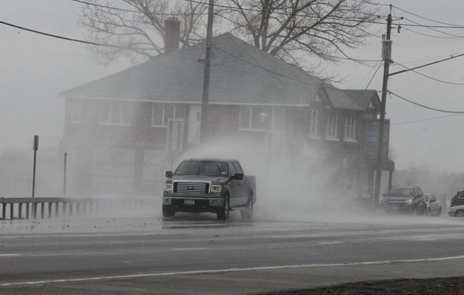 Waves break along Route 5 at and near Hoak's Lakeshore Restaurant in 2012. (John Hickey/News file photo)