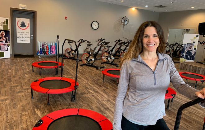 """""""Rebounding is like a detox,"""" says Roxanne Linton, owner of the new Primal Rebound wellness and fitness studio in Elma. """"It's like putting a vacuum cleaner into your body and pulling out all the toxins from your lymphatic system."""" (Scott Scanlon/Buffalo News)"""