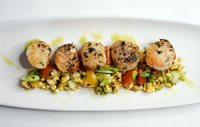 Indoors or out, Water Street Landing offers many a spot to take in the sprawling view and savor fresh seafood, like seared sea scallops with grilled summer corn and heirloom tomatoes. (Dave Jarosz)