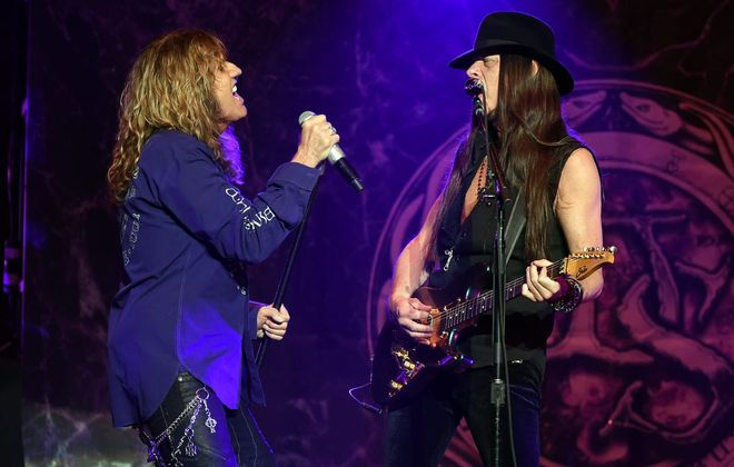 Whitesnake – including singer David Coverdale, left, and guitarist Reb Beach – will be at the Seneca Niagara Events Center in Niagara Falls. (Getty Images)