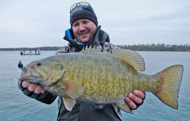 Todd Ceisner of Depew shows off a 6-pound smallmouth bass he caught in the lower Niagara River while fishing with Capt. Ernie Calandrelli. (Photo by Todd Ceisner)