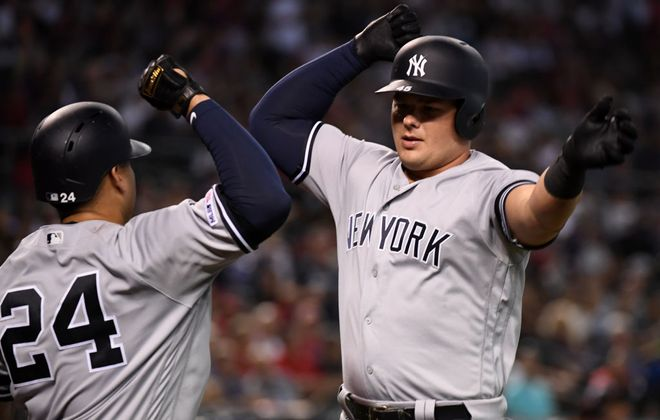 Luke Voit, right, celebrates with Gary Sanchez (24) after hitting his ninth home run of the season for the Yankees Wednesday at Arizona (Getty Images).