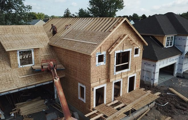 Construction at Colvin Estates in North Buffalo. Builders are focusing on higher-end, rather than entry-level, houses. (John Hickey/Buffalo News file photo)