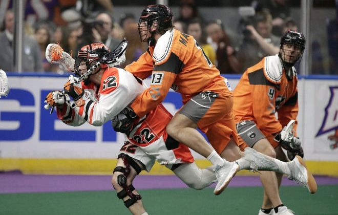 The Bandits' Josh Byrne is interfered with by New England's Jackson Nishimura during the teams' last meeting on April 20. (Harry Scull Jr./ Buffalo News)