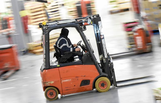 A worker drives a forklift in France. (Getty Images)