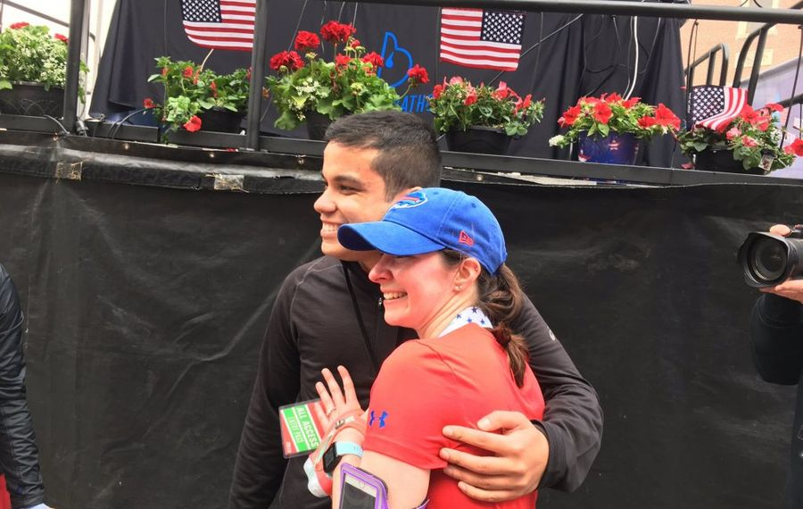 Andrew Torres, left, and Kristin Waldby, got engaged at the finish line of the Buffalo Marathon on Sunday. (Buffalo News)