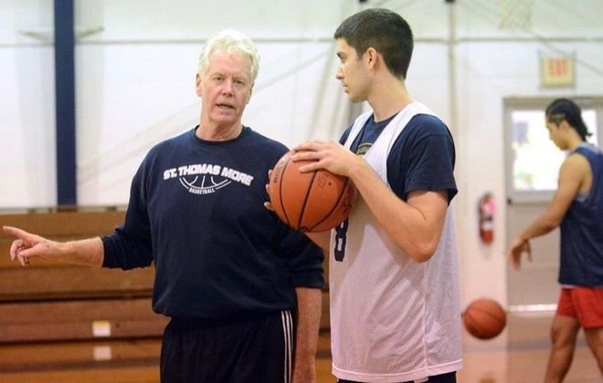 Nick MacDonald, right, talks to St. Thomas More coach Jere Quinn. MacDonald, an Amherst resident, recently committed to play basketball at Niagara University. (Photo courtesy of Nick MacDonald)