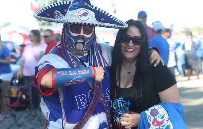 The late Ezra Castro, often called Pancho Billa, at a Buffalo Bills game with Veronica Borjon, his longtime partner. (James P. McCoy/News file photo)